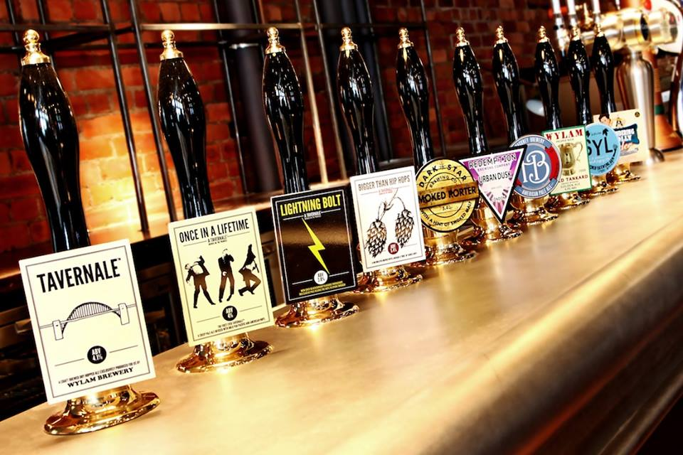 Some of the beer pumps lined up along the bar, in one of the top 10 bars in Newcastle, The Bridge Tavern