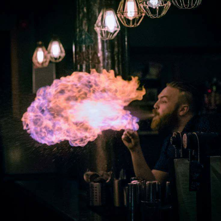 A man blowing fire at the bar in one of the top 10 Newcastle bars, Popolo