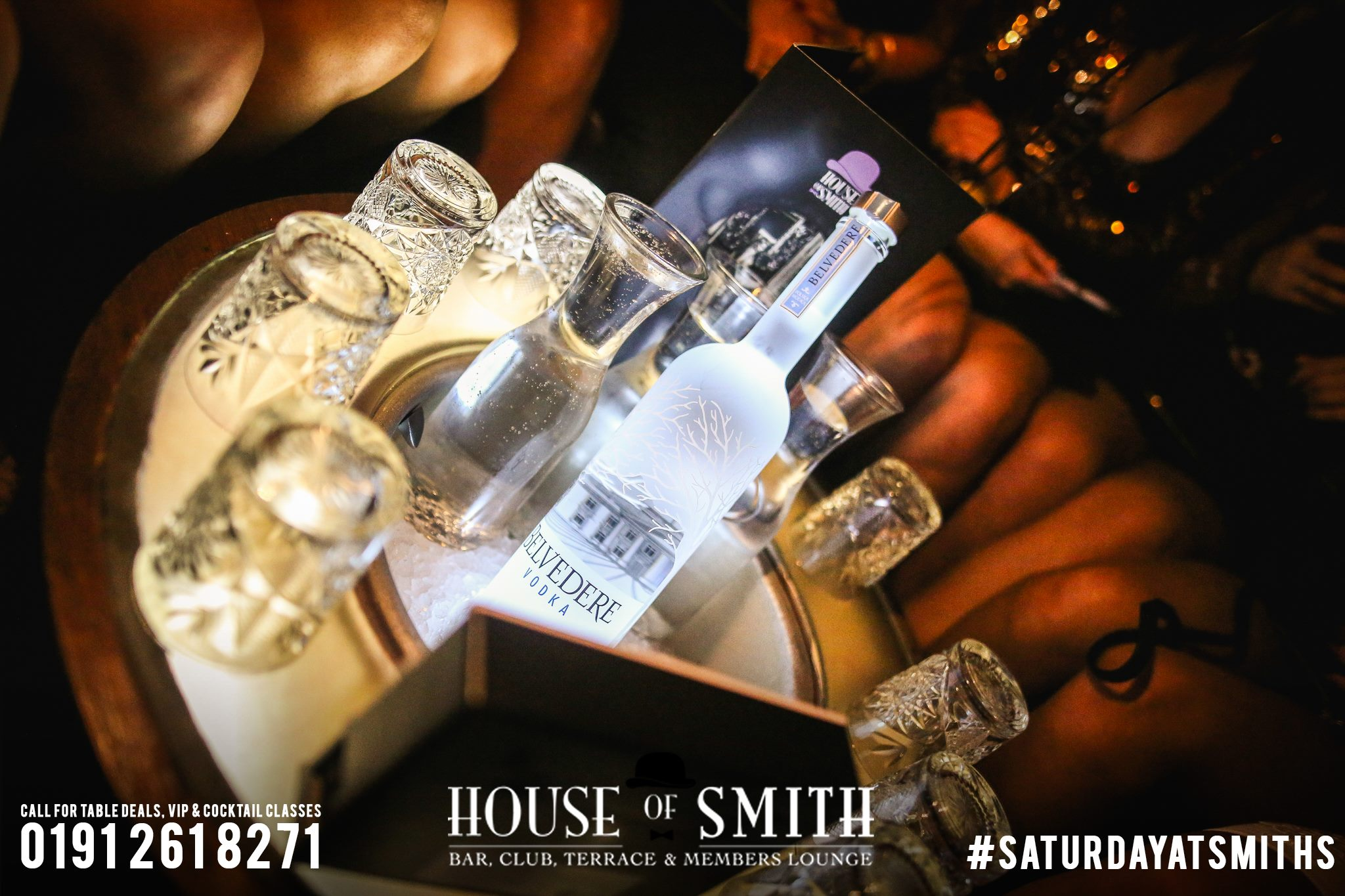 House of Smith Bar Review, with an image of Belvedere vodka in an ice bucket with glasses and mixers