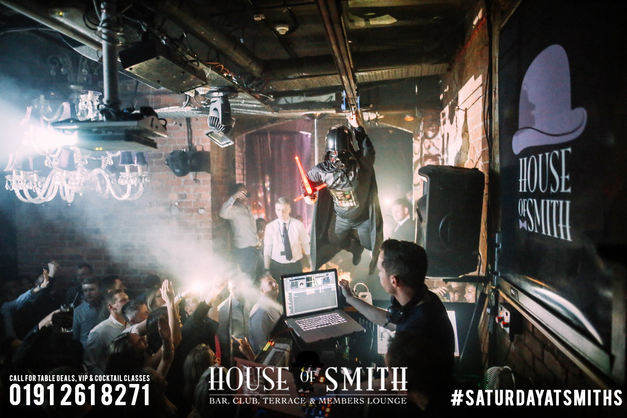House of Smith Bar Review, with an image of people on the dance floor at House of Smith as a dwarf dressed as Darth Vader flies over the DJ booth