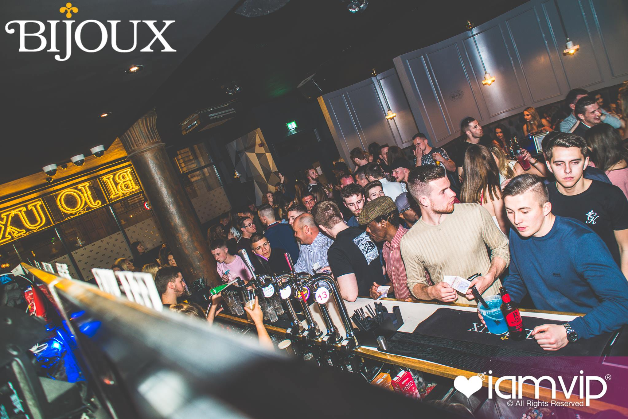 Bijoux Bar Review, featuring an image of people at the bar in Bijoux