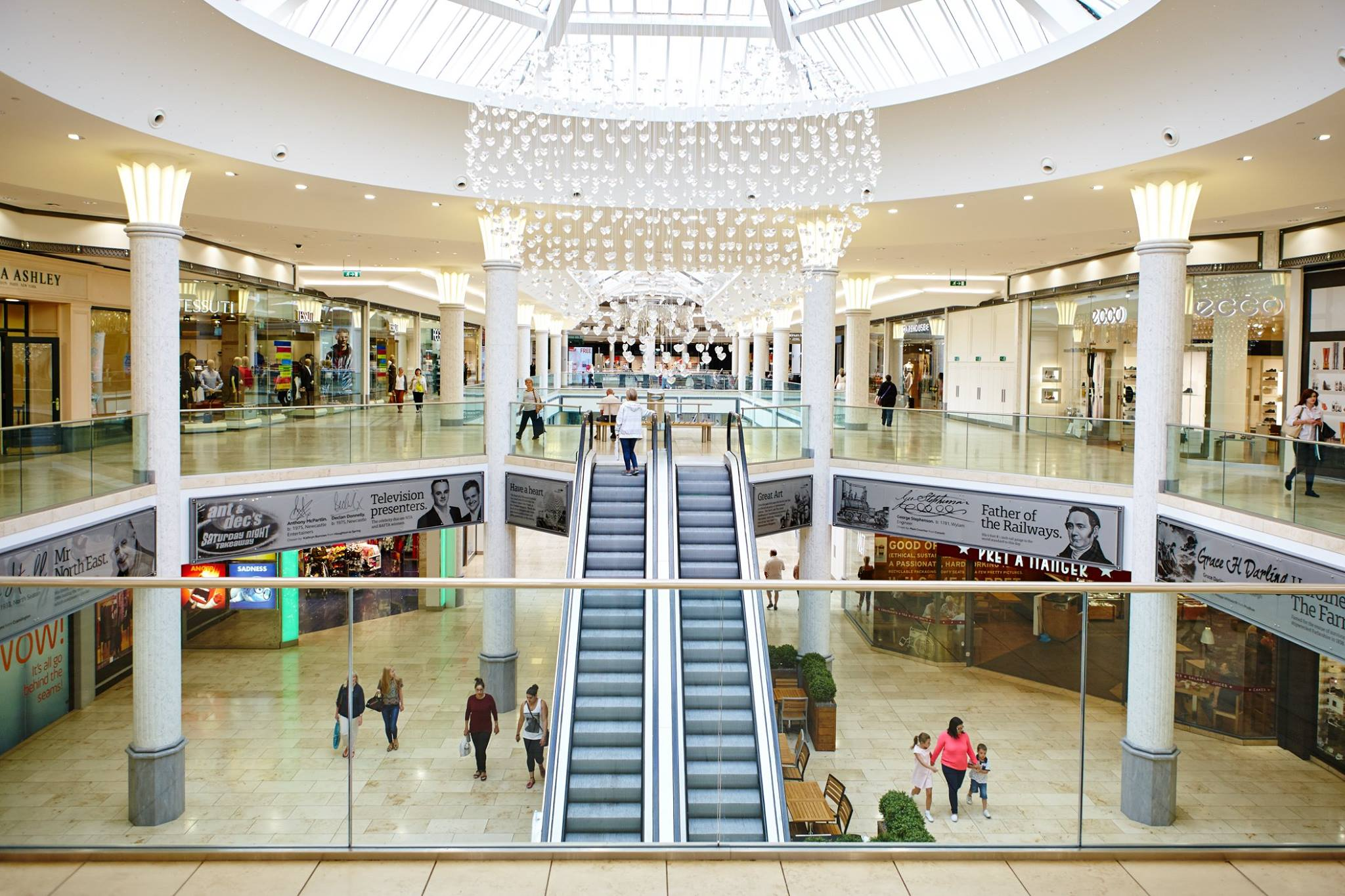 guide to Newcastle, featuring an image of the inside of the Metro Centre