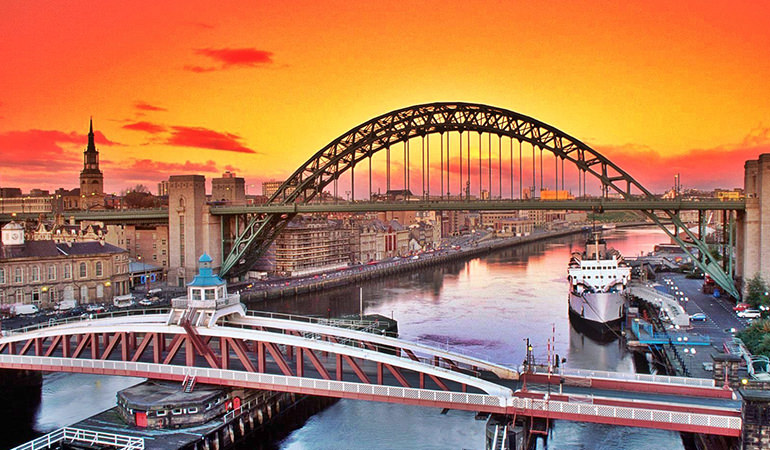 Best city in UK, featuring an image of the Newcastle Quayside at sunset