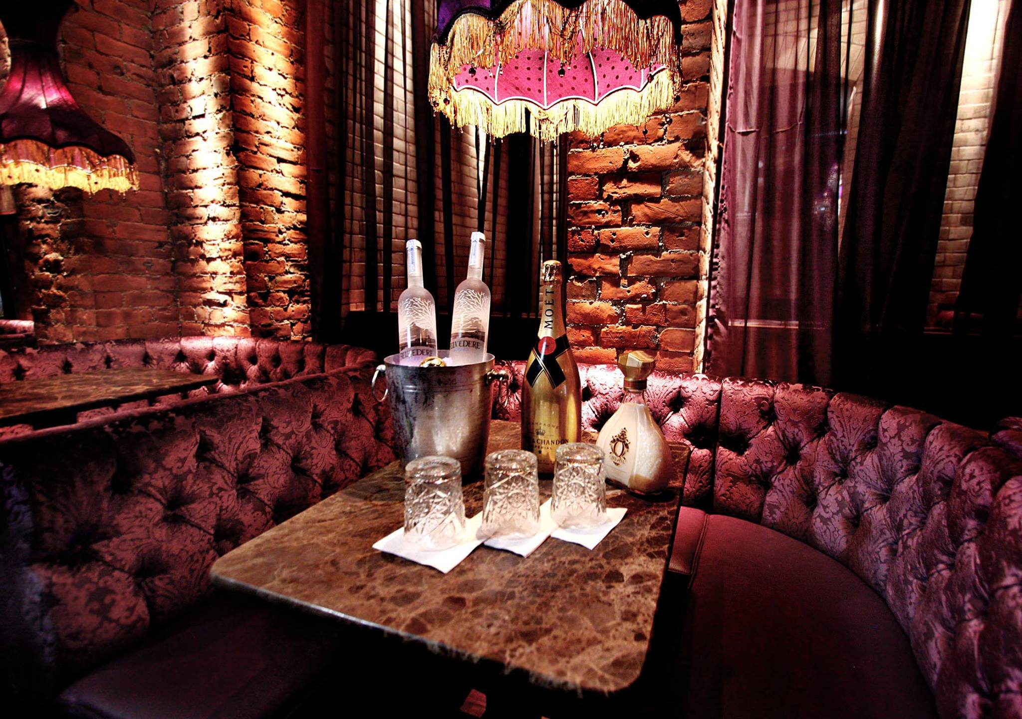 A luxurious red booth in Newcastle nightclub, House of Smith