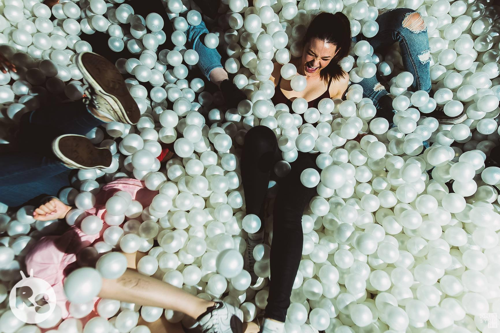Digital Newcastle image of people sat in a ball pool