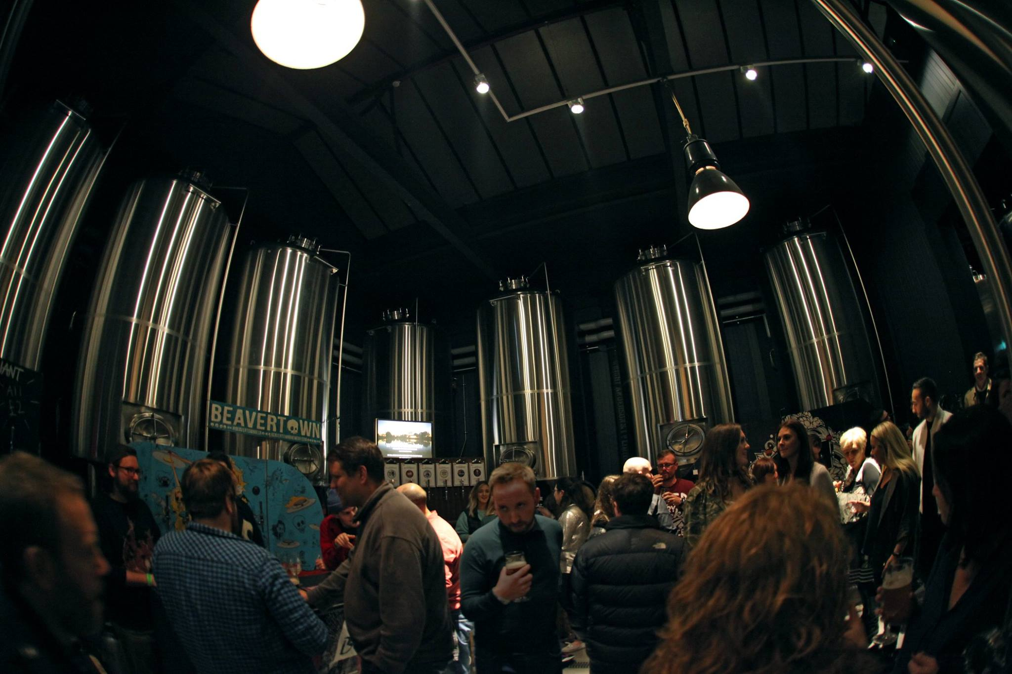 Newcastle's craft beer bars, featuring an image of people inside Wylam Brewery