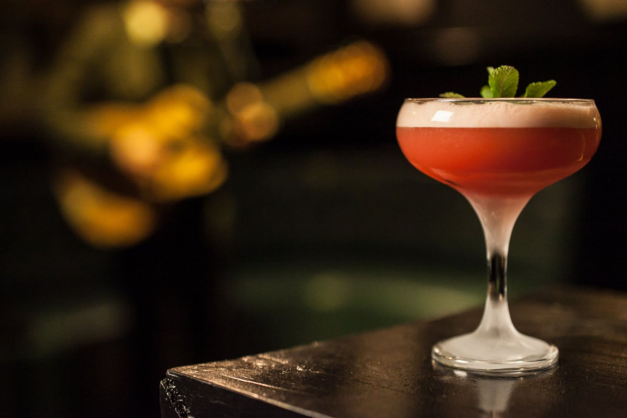 Newcastle's finest cocktail bars, featuring a cocktail in a martini glass from Passing Clouds