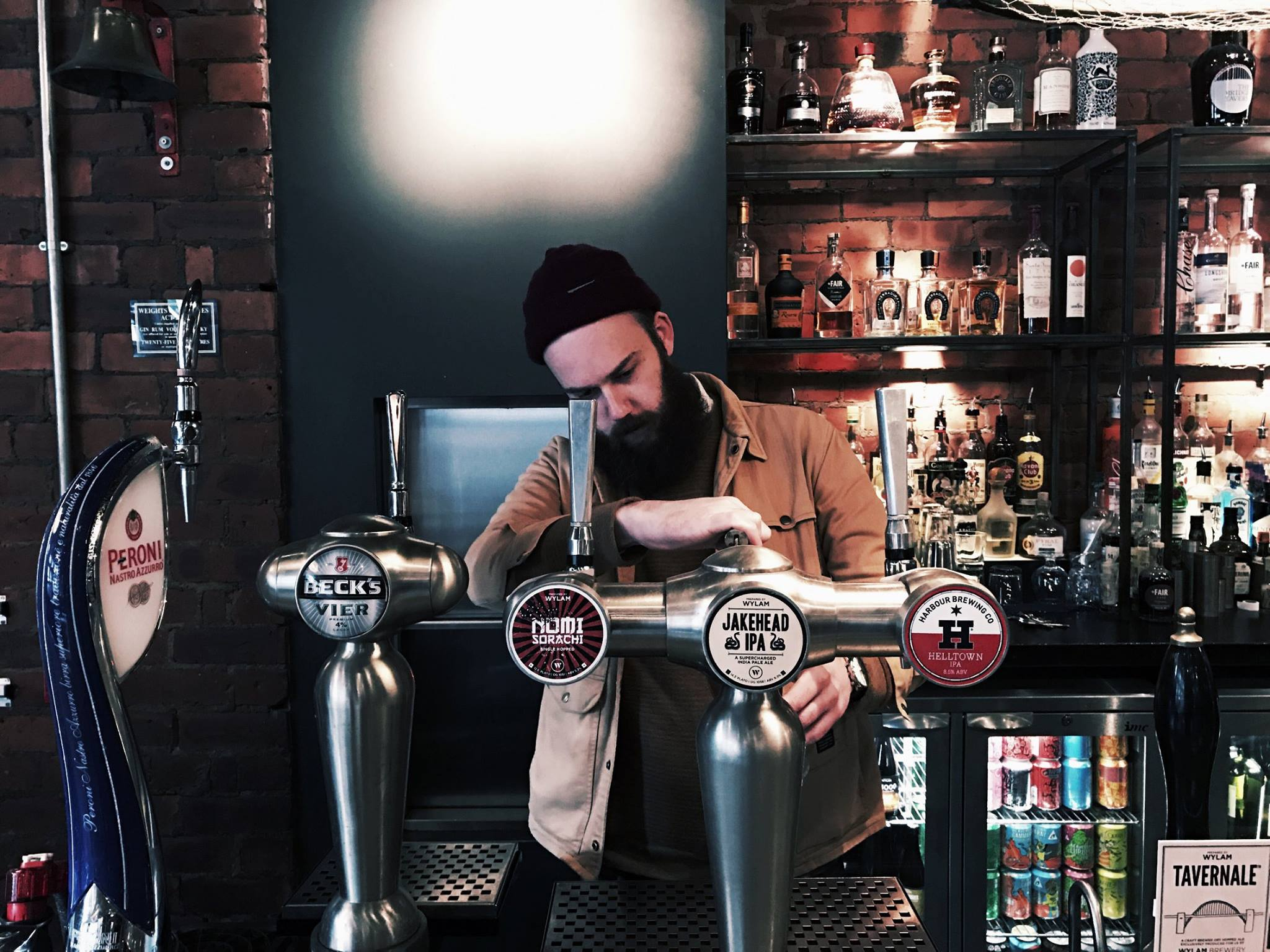 Newcastle's craft beer bars, featuring an image of a bartender pouring a pint at The Bridge Tavern, Newcastle
