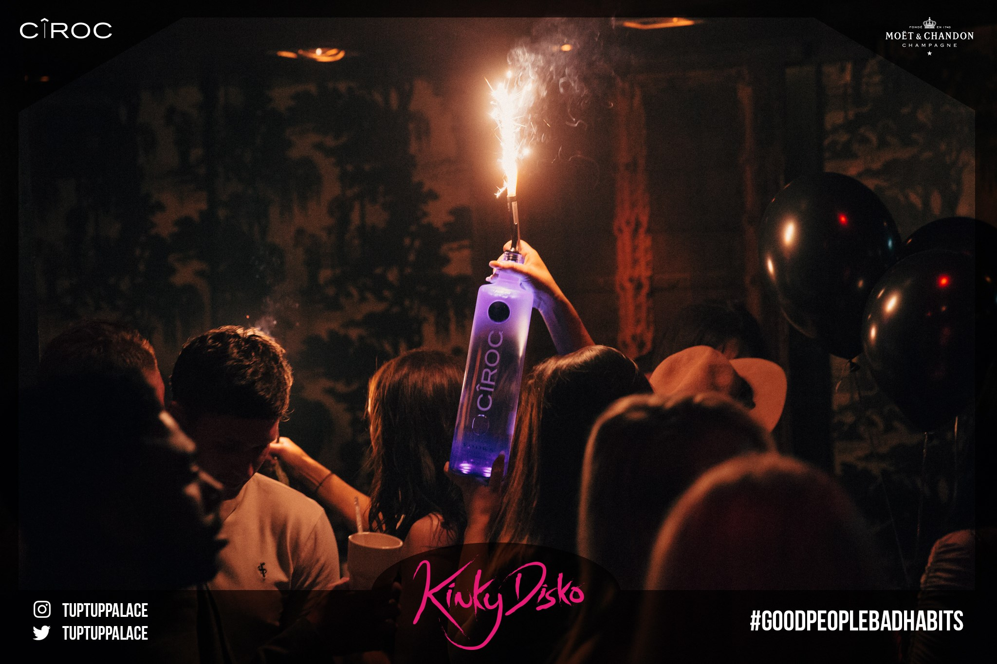 Someone holding a bottle with a sparkler in Tub Tup nightclub, where many celebrity nights out in Newcastle take place