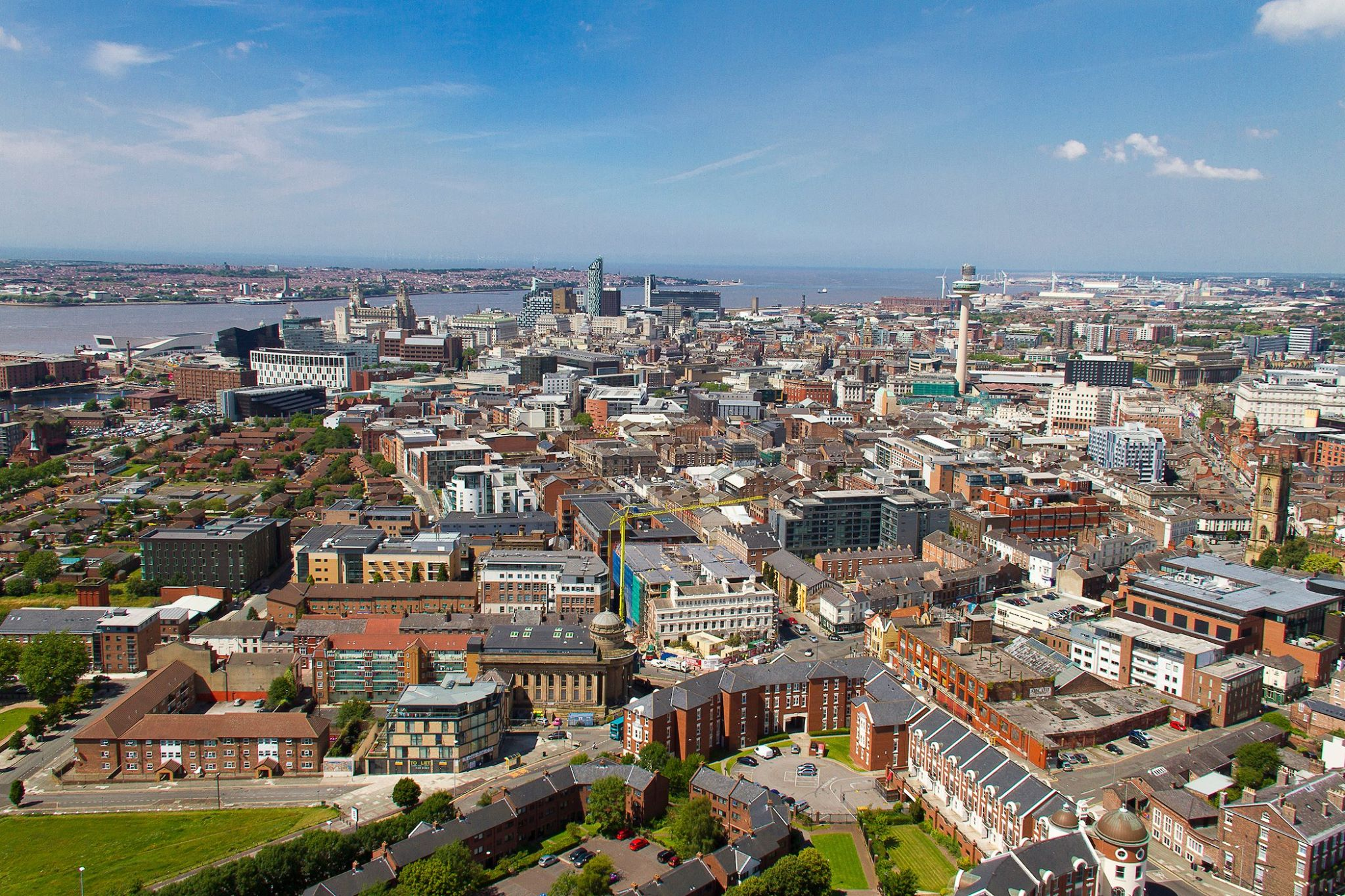Party Universities, with an image of the Liverpool skyline during the day