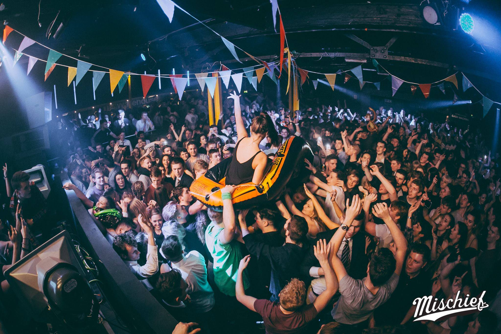 Party Universities, with an image of a woman crowd surfing in a dinghy at The Warehouse, Leeds