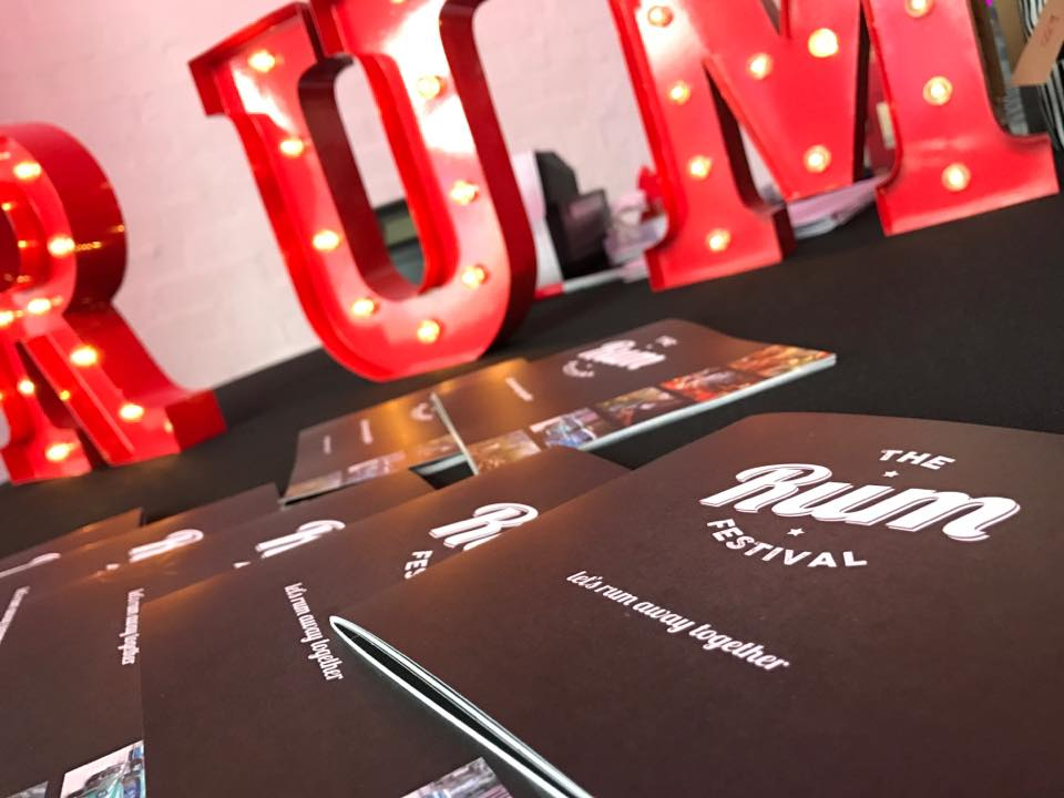 The Rum Festival menus and Rum sign on a table