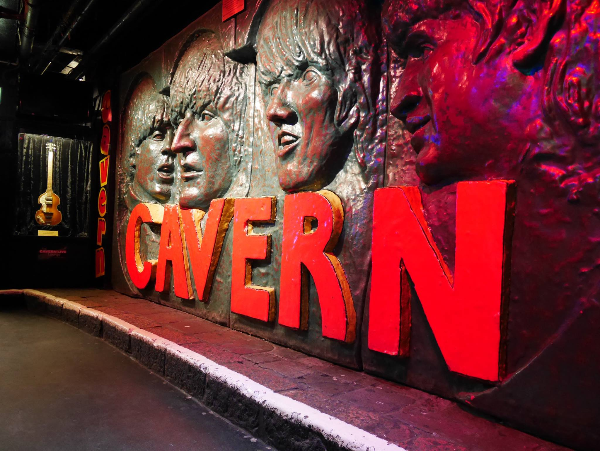 Party Universities, with an image of the sign for Cavern Club with the Beatles heads carved in to the wall